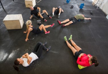 People Stretching in Cross Training Box