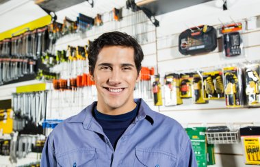 Confident Man Smiling In Hardware Shop