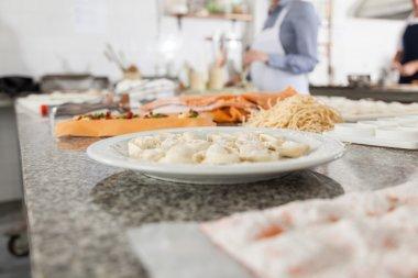 Ravioli And Spaghetti Pasta At Commercial Kitchen Counter