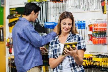 Couple Looking At Products In Hardware Store