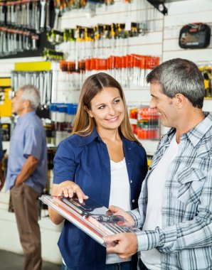 Happy Couple Buying Tool Set In Hardware Stone