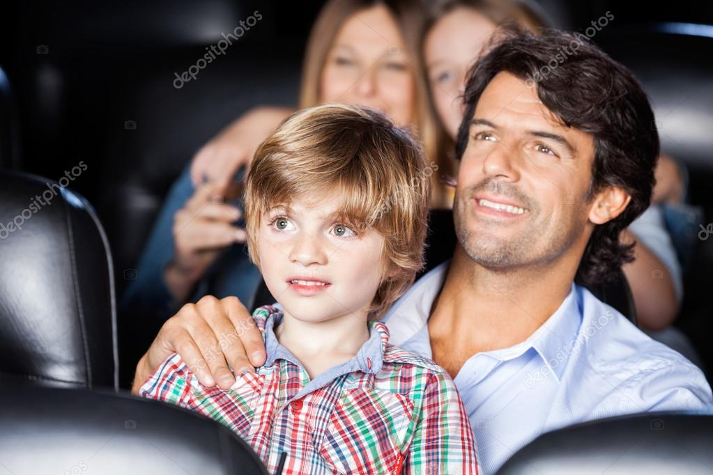 Father And Son Watching Film In Theater
