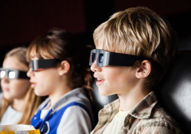 Boy Watching 3D Movie With Siblings