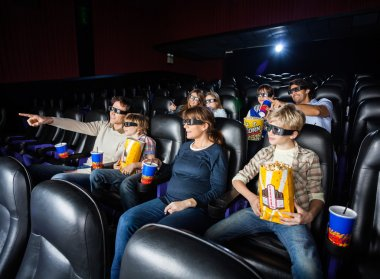 Families Having Snacks In 3D Movie Theater