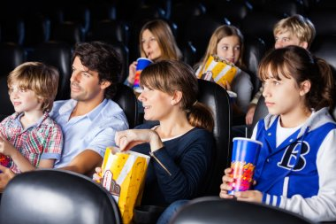 Families Watching Movie In Cinema Theater