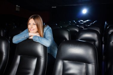 Beautiful Woman Leaning On Seat At Cinema Theater