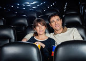 Photo Smiling Couple Watching Film In Theater