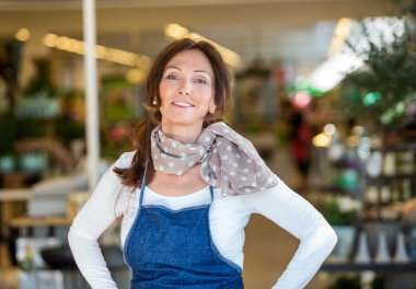 Smiling Woman In Flower Shop