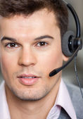 Photo Call Center Employee Wearing Headset In Office