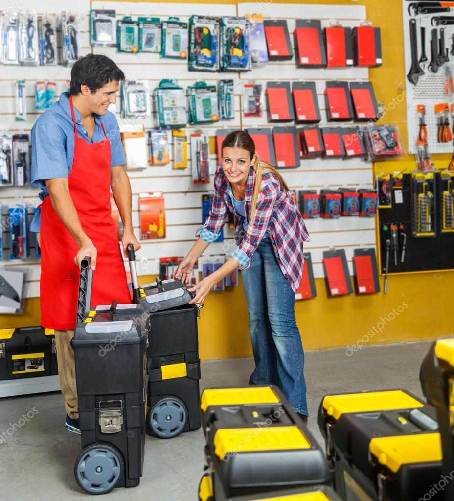 Woman Selecting Tool Cases In Hardware Store
