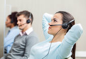 Fotografie Relaxed Female Customer Service Representative Wearing Headset A