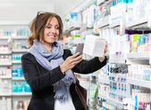 Smiling Customer Scanning Product Through Mobile Phone In Pharma