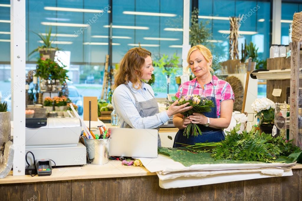 Florists Making Bouquet In Flower Shop
