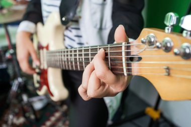Midsection Closeup Of Woman Playing Guitar