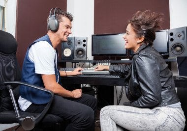 Professionals Mixing Audio In Studio