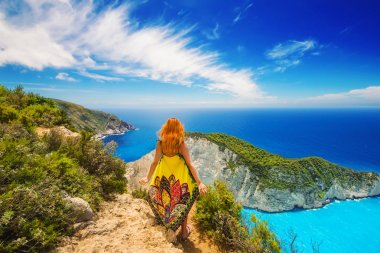 A redhead enjoying the view at Navagio beach, Zakynthos island, Greece