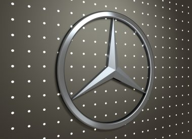 Mercedes Benz emblem on dark grey background.
