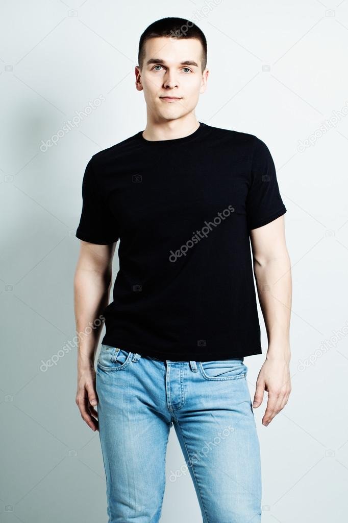 Guy Wearing Black T-Shirt and Blue Jeans — Stock Photo © Artmim ...