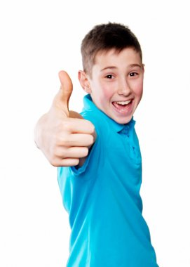 Portrait of a boy pointing finger showing emotions expressive  on a white background with a blue shirt