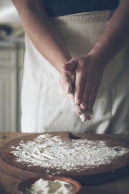 Man making bread in kitchen