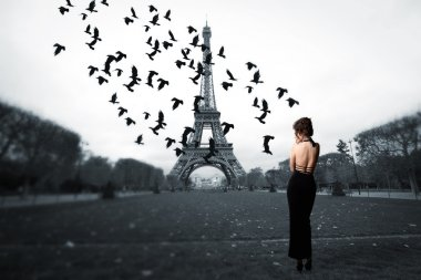 stylish girl stands in the center of Paris