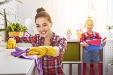 family cleans the room