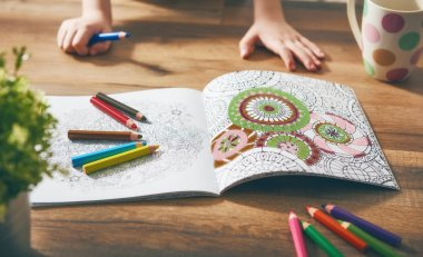 Child paint a coloring book