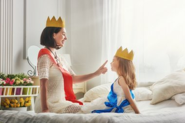 queen and princess in gold crowns