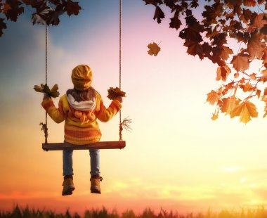 kid playing in the autumn
