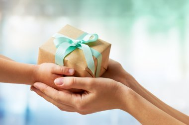 Human hands holding a gift stock vector