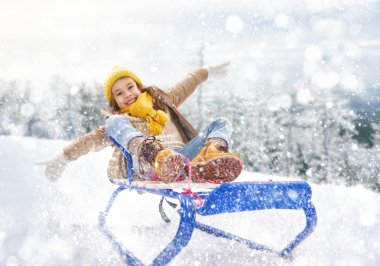 Child sledding. Little girl enjoying a sleigh ride. Child girl riding a sledge. Child plays outdoors in snow. Outdoor fun for family winter vacation. stock vector