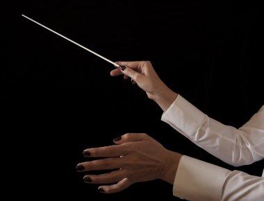 Music female director holding stick