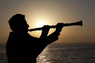 Man playing on oboe