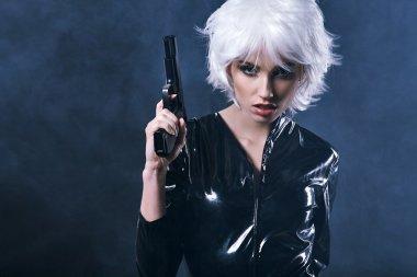 beautiful sexy woman holding gun