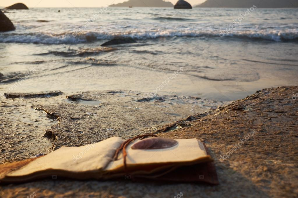 rocky beach with old notebook