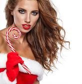 Fotografie dívka, která nosí santa claus oblečení