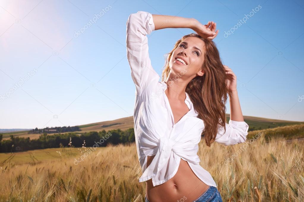 Woman in golden wheat