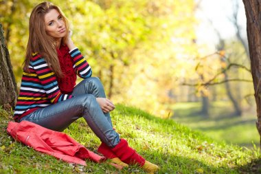 Woman relaxing in autumn forest