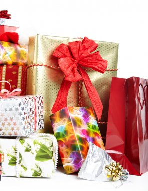 Christmas gifts in colorful wrapping with ribbons