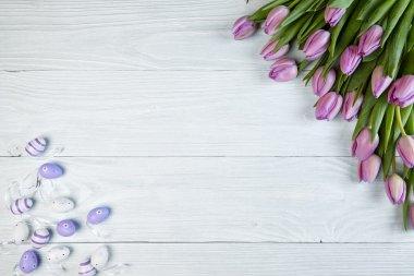 Purple tulips  on old used wood stock vector