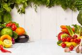 Fotografie Fruit and vegetable borders on wooden table