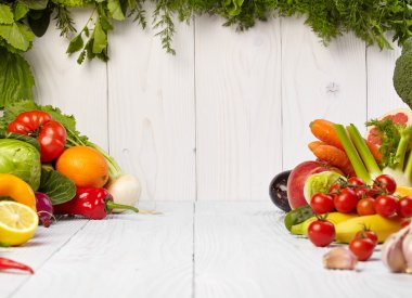 Frame with fresh organic vegetables and fruits on wooden background stock vector