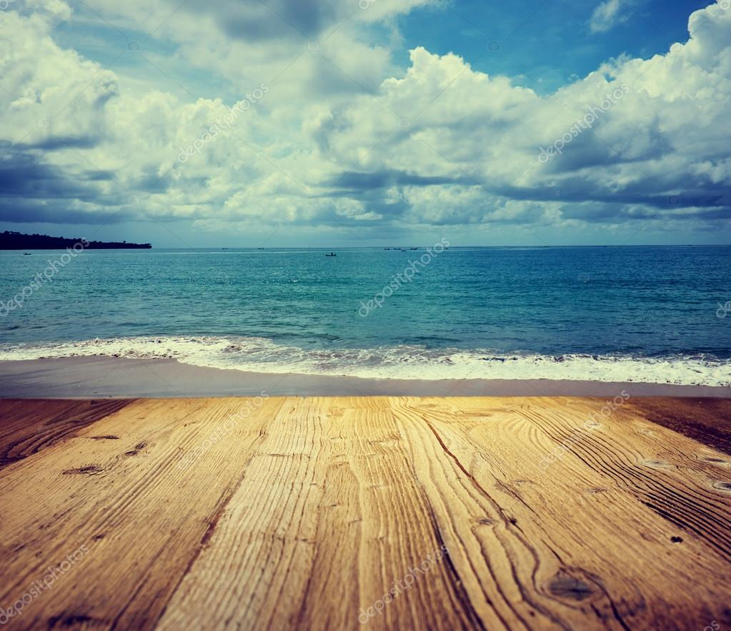 Wooden table background on the tropical beach