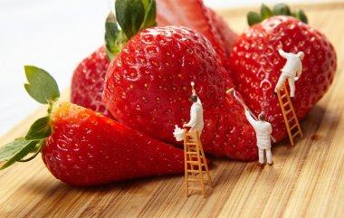 Figures of painters painting strawberries