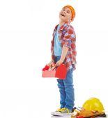 Fényképek Kisfiú játszik építőipari munkás. Elszigetelt fehér