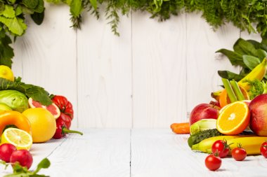 Fruits and vegetables on wooden table