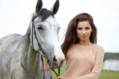 Woman near beautiful horse
