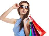 Fotografia bella donna con borse della spesa