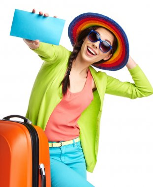 Tourist with travel suitcase and boarding pass