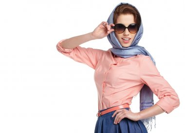 Woman in sunglasses and scarf